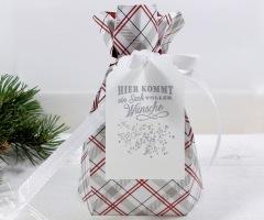 """<a href=""""https://hausvollerideen.de/ein-sack-voller-wuensche-unsere-anleitung/"""" rel=""""noopener noreferrer"""" target=""""_blank"""">Verpackung zu Weihnachten</a>"""